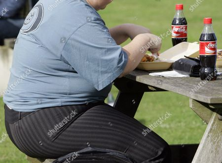 Dated, an overweight person eats in London, Wednesday, Oct. 17, 2007. Almost a third of the world population is now fat, and no country has been able to curb obesity rates in the last three decades, according to a new global analysis released Thursday May 29, 2014, led by Christopher Murray of the Institute for Health Metrics and Evaluation at the University of Washington, USA, and paid for by the Bill & Melinda Gates Foundation. Researchers reviewed more than 1,700 studies covering 188 countries covering over three decades and found more than 2 billion people worldwide classified as overweight or obese. The highest rates of obesity were found in the Middle East and North Africa, with the U.S. having about 13 percent of the world's fat population