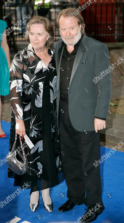 Benny Anderson, Mona Norkilt Former Abba singer Benny Andersson, right, with his wife, Mona Norkilt, poses for the photographers as they arrive for the world premiere of the movie 'Mamma Mia', at a cinema in central London's Leicester Square, . Anderson was the executive producers of the movie