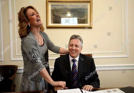 A June 5, 2008 photo from files of Iris Robinson, with her husband, Northern Ireland First Minister. The wife of Northern Ireland's leader will step down as a lawmaker within days, British media reported, as pressure mounted on Peter Robinson's shaky coalition government over her admissions of an affair with a far-younger man. The BBC and Britain's Press Association cited unidentified sources within the Robinson's Democratic Unionist Party as saying that his wife Iris, 60, would relinquish her dual position as parliamentarian in London and representative to Northern Ireland's regional assembly in Belfast within days