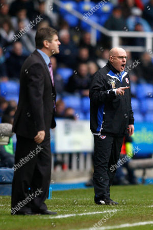 Brian McDermott, Brian Laws Reading's manager Brian McDermott, right, and Burnley's manager Brian Laws during their English FA Cup 4th round soccer match at Madejski Stadium, Reading, England, . (AP Photo/Sang Tan) ** NO INTERNET/MOBILE USAGE WITHOUT FOOTBALL ASSOCIATION PREMIER LEAGUE (FAPL) LICENCE. CALL +44