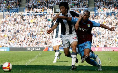 Gabby Agbonlahor Aston Villa's Gabby Agbonlahor, right, Do-Heon Kim battles for the ball during their English Premier League soccer match at the Hawthorns, West Bromwich, England