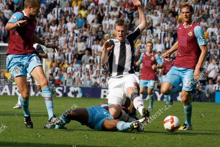 West Ham's Luis Boa Morte, center left, Matthew Upson, left, and Calum Davenport, right, vie for the ball with West Bromwich Albion's Chris Brunt during their English Premier League soccer match at the Hawthorns, West Bromwich, England