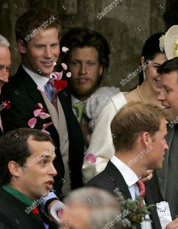 Prince Harry, Prince William Britain's Prince Harry, top left, throws rose petals towards his older brother Prince William, bottom right, as they leave St Cyriac's Church, in Lacock, Wiltshire, England, after attending the wedding of Laura Parker Bowles and Harry Lopes, . Laura Parker Bowles, an art gallery manager and daughter of Prince Charles' second wife Camilla, the Duchess of Cornwall, swapped nuptials with Harry Lopes, a former Calvin Klein underwear model