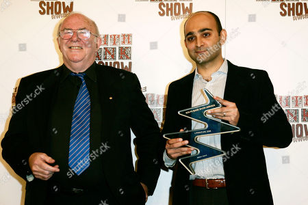 Clive James, Mohsin Hamid Australian television presenter Clive James, left, poses with Mohsin Hamid who has been awarded the Literature Award for his book 'The Reluctant Fundamentalist' during the South Bank Show Awards in London