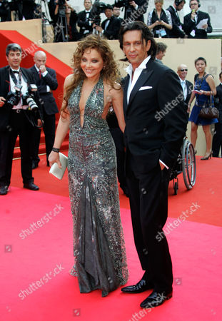 "Stock Image of Ornella Muti, Fabrice Kerherve Italian actress Ornella Muti and Fabrice Kerherve arrive to the opening night ceremony and premiere of the film ""Blindness"" during the 61st International film festival in Cannes, southern France, on"