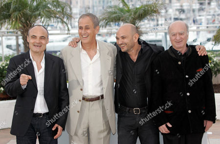 "Philippe Val, Georges Wolinski, Daniel Leconte, Richard Malka From left, chief editor of French satyrical newspaper ""Charlie Hebdo"", Philippe Val, French director Daniel Leconte, Charlie Hebdo's lawyer, Richard Malka and French cartoonist Georges Wolinski pose at the photo call for the documentary film ""C'est Dur d'Etre Aime Par Des Cons,"" during the 61st International film festival in Cannes, southern France, on"