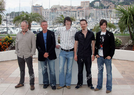 "Stock Image of Liam Cunningham, Stuart Graham, Brian Milligan, Michael Fassbender, Liam McMahon From left, actors Liam Cunningham, Stuart Graham, Brian Milligan, Michael Fassbender and Liam McMahon pose at the photo call for the film ""Hunger"" during the 61st International film festival in Cannes, southern France, on"