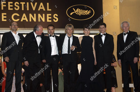 """Fabrizio Rongione, Jean-Pierre Dardenne, Arta Dobroshi, Luc Dardenne, Jeremie Renier, Olivier Gourmet, Alban Ukaj From left, Belgian actors Olivier Gourmet, Belgian director Luc Dardenne, Belgian actors Fabrizio Rongione and Jeremie Renier, actress Arta Dobroshi, Kosovo actor Alban Ukaj and Luc Dardenne's brother Belgian director Jean-Pierre Dardenne depart after the premiere of the film """"Le Silence De Lorna"""" during the 61st International film festival in Cannes, southern France, on"""