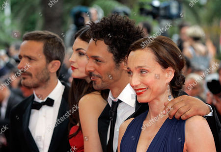 "Stock Image of Kristin Scott Thomas From right, cast of ""Largo Winch"" British actress Kristin Scott Thomas, French actor Tomer Sisley and Serbian actress and model Bojana Panic arrive for the premiere of the film ""Le Silence De Lorna"" during the 61st International film festival in Cannes, southern France"