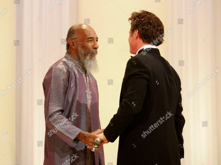 Richie Havens, Sean Penn Musician Richie Havens, left, and American actor, director, and jury president Sean Penn shake hands at the opening night ceremony during the 61st International film festival in Cannes, southern France, on