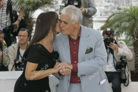 """Monica Bellucci, Marco Tullio Giordana Italian director Marco Tullio Giordana gets a kiss from Italian actress Monica Bellucci as they pose during the photo call for the film """"Une Histoire Italienne"""" during the 61st International film festival in Cannes, southern France, on"""