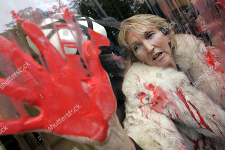 Ingrid Newkirk People for the Ethical Treatment of Animals (PETA) President Ingrid Newkirk stages a protest in a Jean-Paul Gaultier fashion shop in Paris after spraying red paint on the shop window. Peta was protesting the use of fur in fashion
