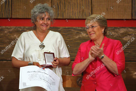 Michelle Bachelet, Laura Esquivel Mexico's writer Laura Esquivel, left, holds her Pablo Neruda Poetry Prize as Chile's President Michelle Bachelet applauds at La Moneda presidential palace in Santiago
