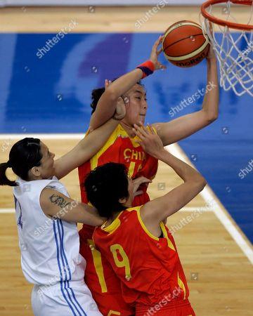 LIN LIU ZHANG Taipei's Lin Huimei, left attempts to stop China's Liu Dan (top) from scoring near China's Zhang Fan (9) during the Women's Basketball finals for the East Asian Games held in Macau, China