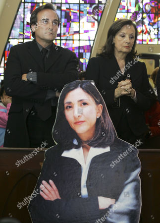 Yolanda Pulecio, Juan Carlos Lecompte Yolanda Pulecio, mother of kidnapped Ingrid Betancourt, right, and Betancourt's husband Juan Carlos Lecompte attend a mass in memory of Betancourt in Bogota, as an image of Betancourt is seen at center. The mass was held to remember Betancourt on the sixth anniversary of her kidnapping by rebels from the Revolutionary Armed Forces of Colombia, or FARC