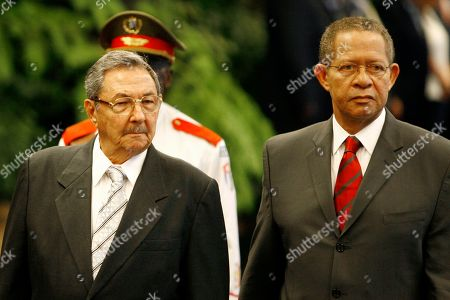 Stock Picture of Orette Bruce Golding, Raul Castro Cuba's President Raul Castro, left, and Jamaica's Prime Minister Bruce Golding review the honor guard during a ceremony at Revolution palace in Havana
