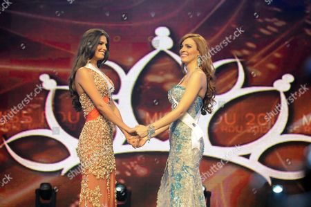 Stock Photo of Carlina Duran, left, and Dulcita Lieggi stand together as they compete in the Miss Dominican Republic beauty pageant in Santo Domingo, Dominican Republic. Lieggi, who placed second, will represent the country in the Miss Universe international competition after Duran lost her crown due to the discovery that she wed in 2009. Miss Dominican Republic Director Magaly Febles says contestants must be single