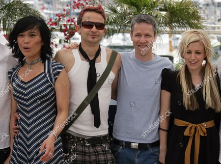 BEAMISH American director John Cameron Mitchell, second from right, sticks out his tongue with Actors Sook Yin Lee, Raphael Barker, and Lindsay Beamish for his out of competition film 'Shortbus,' at the 59th International film festival in Cannes, southern France