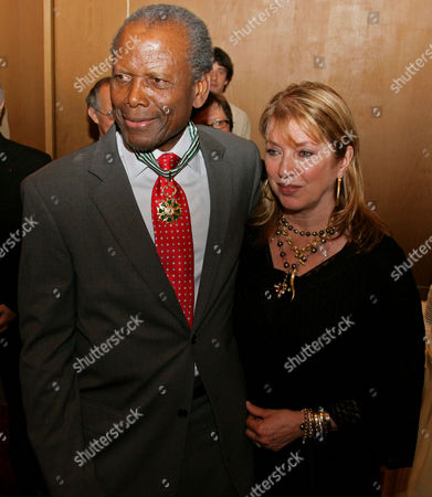 SHIMKUS American actor Sidney Poitier, left, is seen with his wife Joanna Shimkus after being awarded Commander in the Order of the Arts and Letters by France's Minister of Culture Renaud Donnedieu de Vabres during a ceremony at the Festival Palace, at the 59th International film festival in Cannes, southern France, on