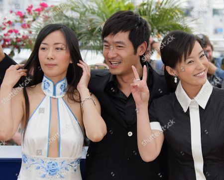 """XIAODONG Chinese actress Hu Ling Ling, left, actor Guo Xiaodong, center, and actress Hao Lei pose during a photo call for the film """"Summer Palace,"""" at the 59th International film festival in Cannes, southern France, on . This film will be shown in competition tonight"""