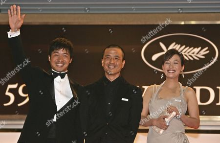 """YE Chinese actress Hao Lei, right, director Lou Ye, center, and actor Guo Xiaodong arrive for the screening of """"Summer Palace,"""" at the 59th International film festival in Cannes, southern France, on"""
