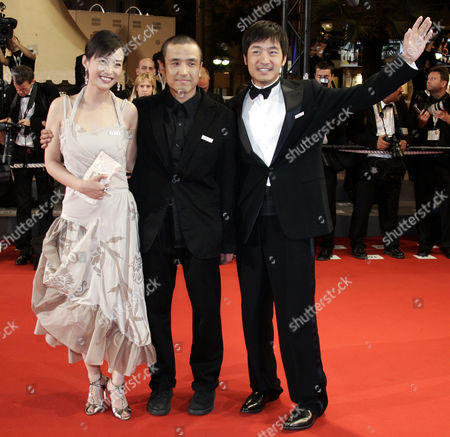 """YE Chinese actress Hao Lei, left, director Lou Ye, center, and Guo Xiaodong arrive for the screening of """"Summer Palace,"""" at the 59th International film festival in Cannes, southern France, on"""