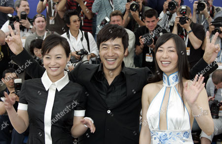 """LEI Chinese actors Hao Lei, left, Guo Xiaodong, center, and Hu Ling Ling pose during a photo call for the film """"Summer Palace,"""" at the 59th International film festival in Cannes, southern France, on . This film will be shown in competition tonight"""
