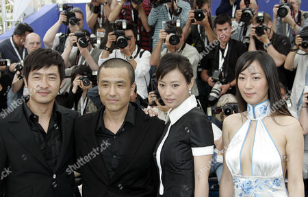 """LEI Chinese actor Guo Xiaodong, left, director Lou Ye, actress Hao Lei, and actress Hu Ling Ling pose during a photo call for the film """"Summer Palace,"""" at the 59th International film festival in Cannes, southern France, on . This film will be shown in competition tonight"""