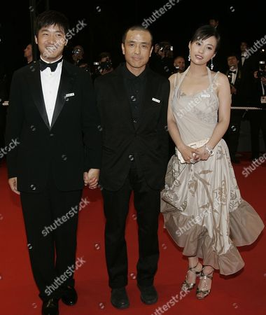 """Stock Photo of Chinese actor Guo Xiaodong, left, Chinese director Lou Ye, center, and Chinese actress Hao Lei arrive for the screening of """"Summer Palace,"""" at the 59th International film festival in Cannes, southern France, on"""