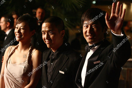 """Chinese actress Hao Lei, left, director Lou Ye, center, and actor Guo Xiaodong arrive for the screening of """"Summer Palace,"""" at the 59th International film festival in Cannes, southern France, on"""