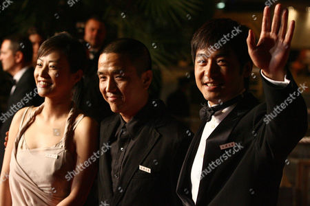 """Stock Image of Chinese actress Hao Lei, left, director Lou Ye, center, and actor Guo Xiaodong arrive for the screening of """"Summer Palace,"""" at the 59th International film festival in Cannes, southern France, on"""