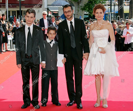 """Raphael Nadjari, Michael Moshonov, Yonathan Alster, Limor Goldstein French Director Raphael Nadjari, second right, and Israeli cast members, from left, Michael Moshonov, Yonathan Alster, and actress Limor Goldstein arrive for the screening of the film """"Tehilim,"""" at the 60th International film festival in Cannes, southern France, on"""