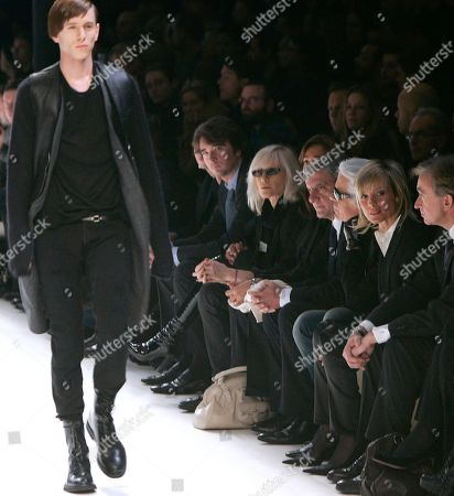 Bernard Arnault,Helene Mercier, Karl Lagerfeld A model wears a creation by French fashion designer Hedi Slimane for the Dior autumn-winter 2007-2008 men's fashion collection presented in Paris, . French designer Hedi Slimane on Tuesday delivered the boldest answer so far to the question that has been preoccupying designers from Paris to Milan this season: how to reinvent trousers for the modern man. The chairman of luxury goods company LVMH, Bernard Arnault, is seen at right, with his wife Canadian musician Helene Mercier, second right, and German fashion designer Karl Lagerfeld, third right
