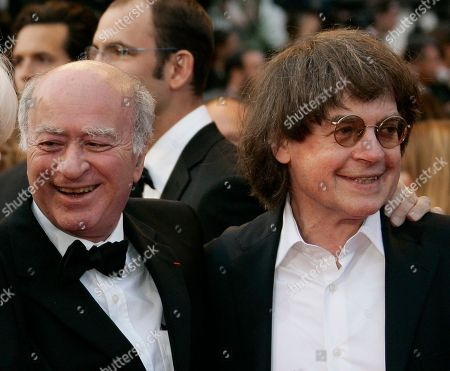 """French cartoonists Georges Wolinski, left, and Jean Cabut who is also known as 'Cabu' arriving at the premiere of the film """"C'est Dur d'Etre Aime Par Des Cons"""" during the 61st International film festival in Cannes, southern France. Scattered gunfire and explosions shook France on Thursday as its frightened yet defiant citizens held a day of mourning for 12 people slain, including Wolinski and Cabut, at a Paris newspaper. French police hunted down the two heavily armed brothers suspected in the massacre to make sure they don't strike again"""