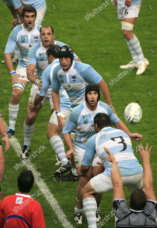 Argentina's players, from top, Juan Martin Fernandez Lobbe, Gonzalo Longo Elia, Patricio Albacete, Carlos Ignacio Fernandez Lobbe and Martin Scelzo wait for a lineout during the Rugby World Cup quarterfinal match between Argentina and Scotland at the Stade de France in Saint-Denis, outside Paris