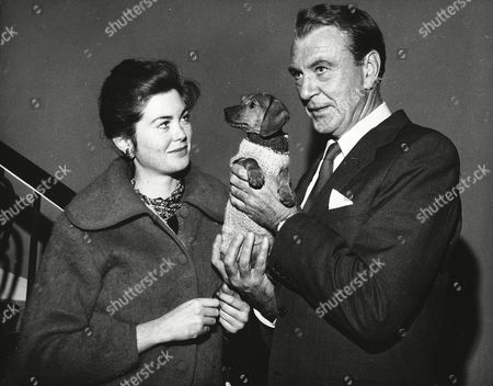Gary Cooper, Maria Cooper Undated photograph of Gary Cooper and his daughter Maria with their family dog