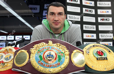 FILE - In this file picture Ukrainian boxer Wladimir Klitschko poses with his belts in Ludwigshafen, Germany. Wladimir Klitschko's promoter Bernd Boente says the WBA, IBF and WBO heavyweight champion has been taken to a Duesseldorf hospital with abdominal pains. Boente told German news agency dapd Friday night Dec. 2, 2011 that Klitschko is displaying symptoms of renal colic, a pain commonly caused by kidney stones. Boente says Klitschko's bout against French challenger Jean-Marc Mormeck on Dec. 10, is not in danger