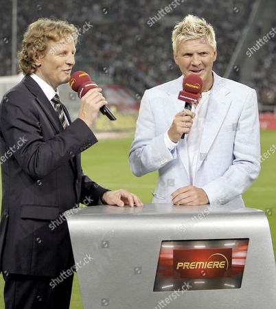 Dieter Nickles, Stefan Effenberg TV presenter Dieter Nickles, left, and former German soccer player Stefan Effenberg, right, talk during a TV presentation of the pay TV station Premiere prior to a German first division soccer match between Borussia Moenchengladbach and Borussia Dortmund at the Borussia Park stadium in Moenchengladbach, Germany