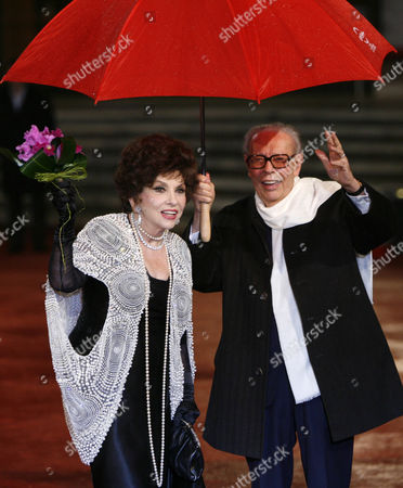 Gina Lollobrigida, Gianluigi Rondi Italian actress Gina Lollobrigida, left, and Rome International Film Festival President Gianluigi Rondi arrive at the award ceremony of the festival's third edition, in Rome