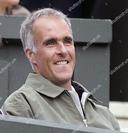 Former top-five player Todd Martin watches Rafael Nadal play Mardy Fish in a Men's Singles, first round match on the Centre Court at the Wimbledon Tennis Championships. Martin has been selected as the next CEO of the International Tennis Hall of Fame & Museum. He will succeed Mark L. Stenning, who is stepping down in September, 2014, after 35 years with the organization and 14 years as CEO