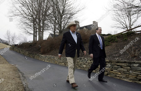 Mike Huckabee, Ray Scott Republican presidential hopeful, former Arkansas Governor Mike Huckabee, walks to talk with the media with Ray Scott, left, in Traveler's Rest, S.C