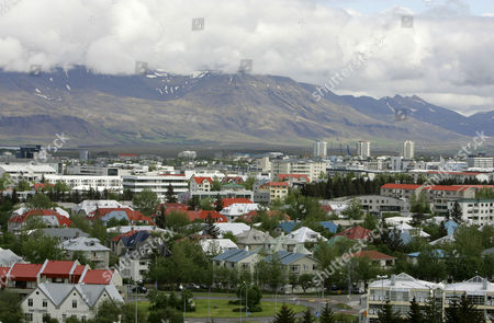 """A view across Reykjavík in Iceland from Öskjuhlíd Hill. In recent years the country has welcomed eccentric chess master Bobby Fischer, WikiLeaks secret-spiller Julian Assange and the online freedom advocates of the Pirate Party. Could its next guest be NSA leaker Edward Snowden? In an interview outing himself as the source behind stories about the U.S. spy agency's online surveillance programs, Snowden floated the idea of heading to Reykjavik. He told The Guardian newspaper that he was inclined to seek asylum in a country that shared his values _ and """"the nation that most encompasses this is Iceland"""