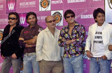 BOLLYWOOD ACTORS Bollywood actors, from left, Jackie Shroff, Suniel Shetty, Anupam Kher, Chunky Pandey and Ritesh Deshmukh looks on during the 27th anniversary celebrations of Mukta Arts in Bombay, India, . The actors will feature in Mukta arts new Hindi movie 'Money Money Money
