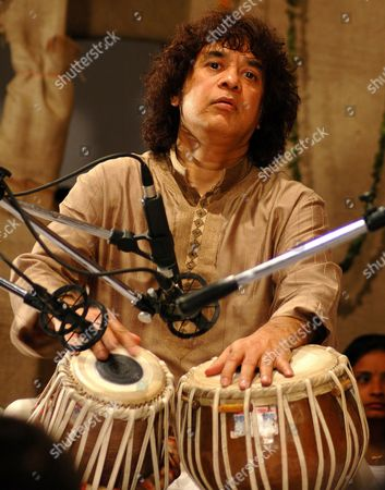 ZAKIR HUSSAIN Indian tabla maestro Ustad Zakir Hussain performs at a music festival in Ahmadabad, India