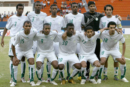 Ahmed Al Bahari, Malek Al Hawsawi, Ahmed Al Mousa, Taiseer Al Jassam, Abdulrahman Al Qahtani, Kamil Al Mousa, Osama Hawsawi, Walid Jahdali, Saud Khariri, Saudi Arabia's Yaser Al Mosailem and Yasser Al Qahtani The Saudi Arabia soccer team, front left-right, Ahmed Al Bahari, Malek Al Hawsawi, Ahmed Al Mousa, Taiseer Al Jassam, Abdulrahman Al Qahtani, and back left-right, Kamil Al Mousa, Osama Hawsawi, Walid Jahdali, Saud Khariri, Saudi Arabia's Yaser Al Mosailem and Yasser Al Qahtan, poses for a group photo just before their soccer match between Bahrain during the AFC (Asian Football Confederation) Asian Cup 2007 Group D soccer match at Jaka Baring Stadium in Palembang, Indonesia