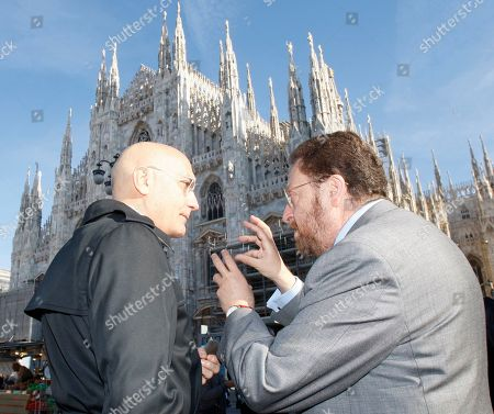 Gabriele Albertini, Riccardo De Corato Former Milan's mayor Gabriele Albertini, left, speaks with Milan's vice-mayor Riccardo De Corato as they attend the Italian Armed Forces celebration day, in front of the Duomo gothic cathedral in Milan, Italy