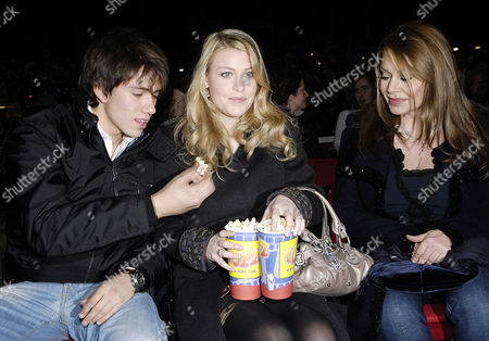 Eawatchf AP I ITA NYOTK ITALY BERLUSCONI FAMILY Veronica Lario, right, wife of Silvio Berlusconi, attends with her son Luigi, left, and her daughter Barbara at the Italian comedian Roberto Benigni's show in Milan, Italy