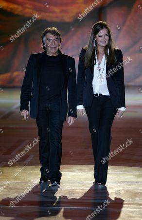 Robert Cavalli, Eva Cavalli Italian designer Robert Cavalli and his wife Eva acknowledge the applause at the end of his Roberto Cavalli women's Fall/Winter 2008/2009 collection presented in Milan, Italy