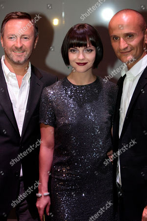 Kevin Carrigan, Christina Ricci, Mark Carrasquillo Actress Christina Ricci, center, poses with Kevin Carrigan, left, the Creative director of ck Calvin Klein and Mark Carrasquillo, the Global Make-up artist of ck Calvin Klein beauty, in Milan, Italy