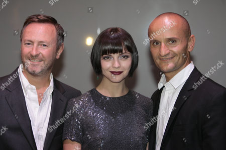 Actress Christina Ricci, center, poses with Kevin Carrigan, left, the Creative director of ck Calvin Klein and Mark Carrasquillo, the Global Make-up artist of ck Calvin Klein beauty, in Milan, Italy